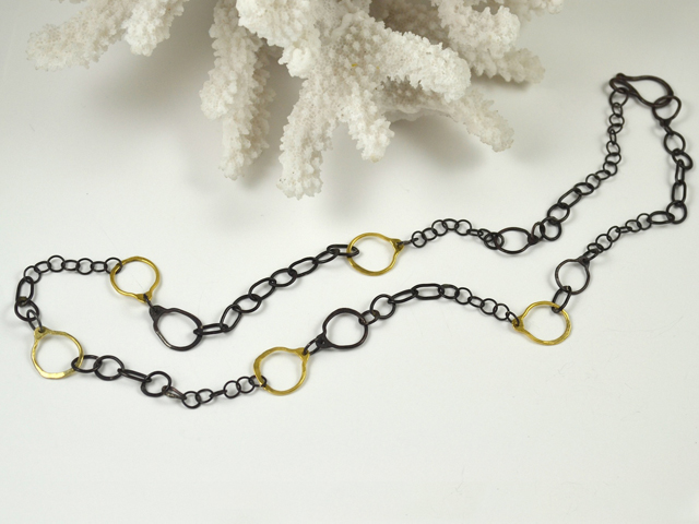 Amy Nordstrom's sterlng and 14k gold chain link necklace can be worn as a long single strand or can be    doubled