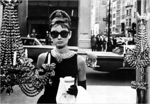 "Audrey's famous pose from Breakfast at Tiffany's in the ""Manhattan"" sunglasses."
